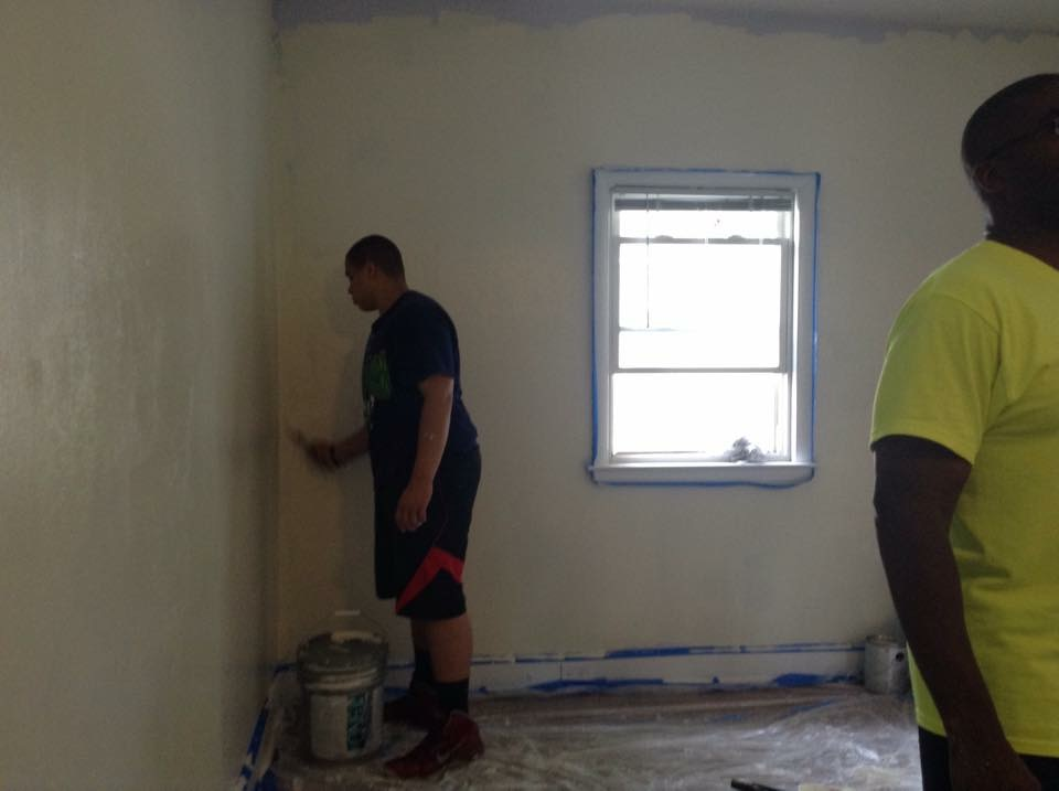 community outreach - painting a room